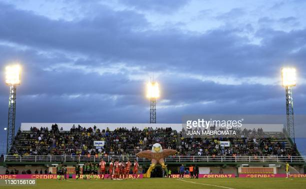 Footballers of Defensa y Justicia and Argentinos Junior leave the pitch through an inflatable tunnel depicting a falcon in allusion to Defensa y...