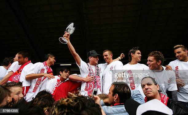 Footballers of Essen celebrate with their fans after the end of the Third League match between Rot Weiss Essen and Werder Bremen II at the...