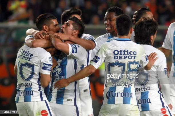 Footballers of Mexico´s Pachuca celebrates his goal against Costa Rica´s Deportivo Saprissa during the second leg quarterfinal of the CONCACAF...