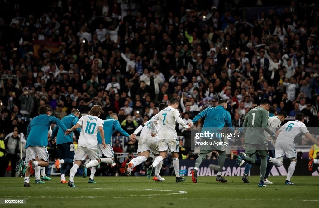 Footballers of Real Madrid celebrate their victory at the end of the UEFA Champions League semi final second leg match between Real Madrid and FC Bayern Munich at the Santiago Bernabeu Stadium in Madrid, Spain on May 1, 2018.