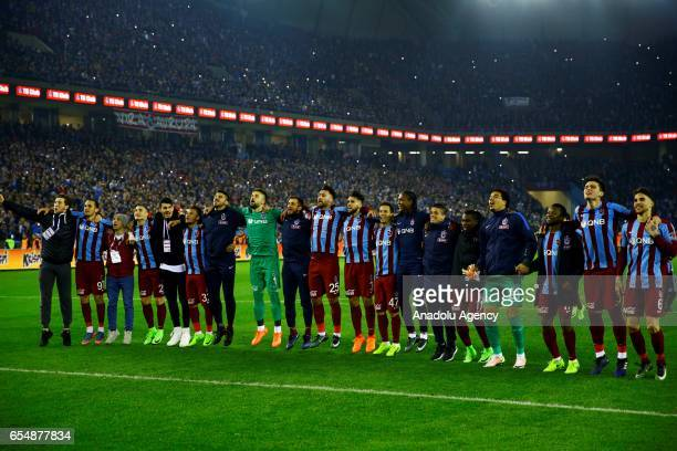 Footballers of Trabzonspor celebrate after their victory at the end of the Turkish Spor Toto Super Lig football match between Trabzonspor and...