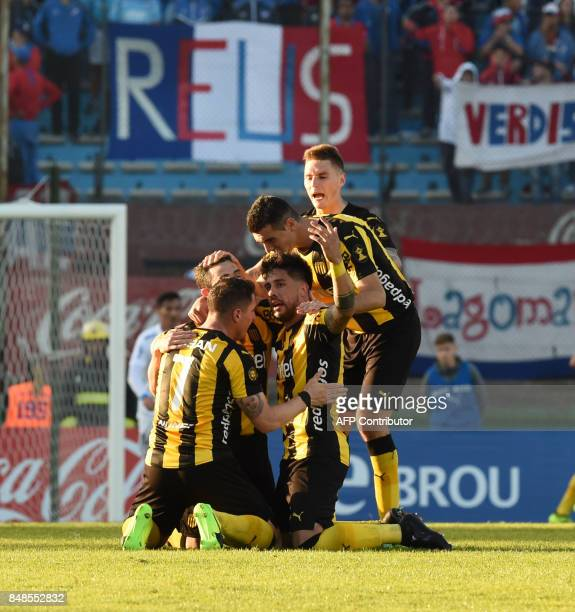 Footballers of Uruguay's Penarol celebrate after scoring against Nacional during their classic match at the Centenario stadium in Montevideo on...