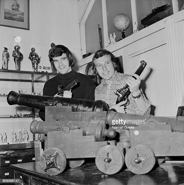 Footballers Peter Storey and Bob McNab of Arsenal FC visit an antique shop in Islington London UK 16th April 1971