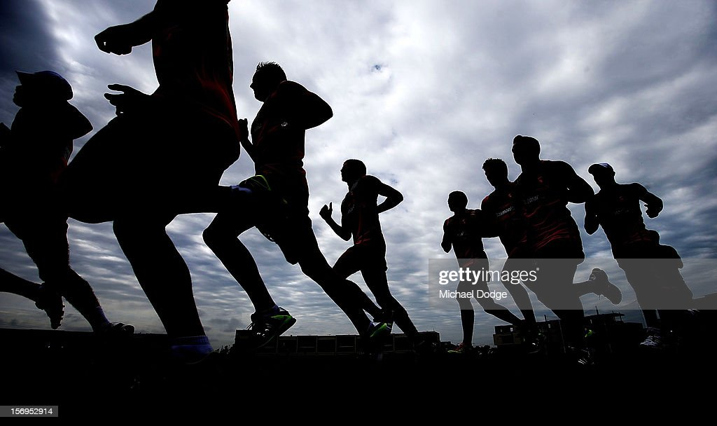 Footballers run some hard laps of the oval during a Hawthorn Hawks pre-season AFL training session at Waverley Park on November 26, 2012 in Melbourne, Australia.