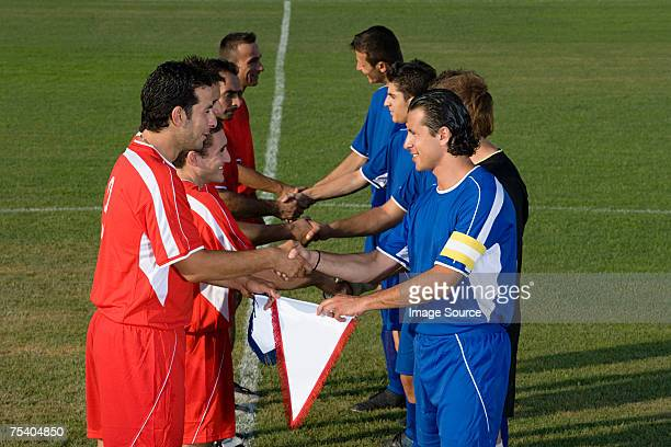footballers shaking hands - exchanging stock pictures, royalty-free photos & images
