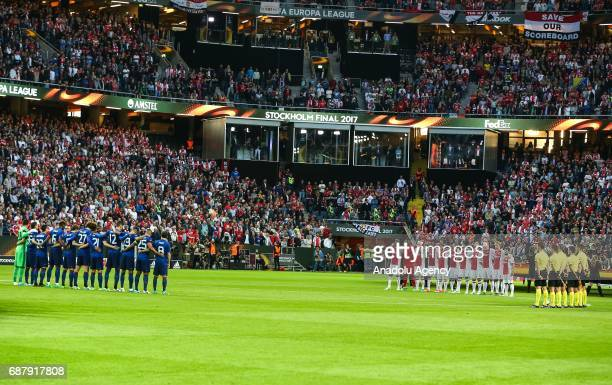 Footballers stand in silence in memory of recent Manchester Arena terrorist attack victims during the UEFA Europa League final match between...