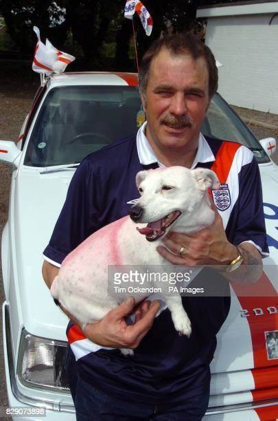 Footballmad Richard Woods and his pet Jack Russell dog Pippa who he has painted with a cross of St George Worthing West Sussex Tuesday June 15 2004...