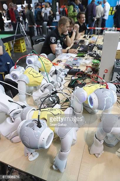 Footballplaying robots undergo programming at the Robocup field at the 2016 Berlin Maker Faire on October 1 2016 in Berlin Germany The Maker Faire...