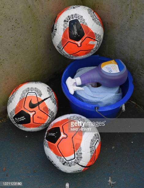Footballs and sanitising equipemnet are seen in the stadium ahead of the English Premier League football match between Brighton and Hove Albion and...