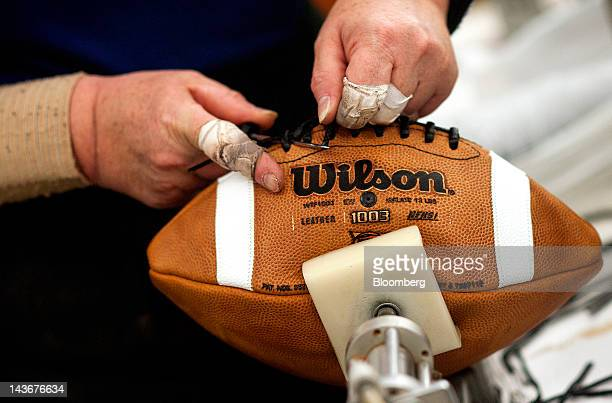 Footballs are laced by hand at the Wilson Sporting Goods Co Wilson Football Factory in Ada Ohio US on Wednesday May 2 2012 Since 1941 every NFL game...