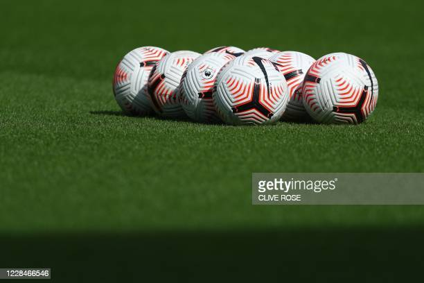 Footballs are pictured on the grass ahead of the the English Premier League football match between Fulham and Arsenal at Craven Cottage in London on...