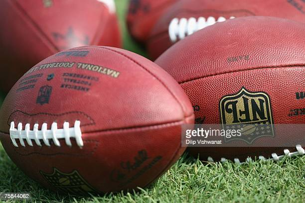 Footballs lay in the grass at the St Louis Rams training camp at the Russell Training Facility on July 28 2007 in St Louis Missouri