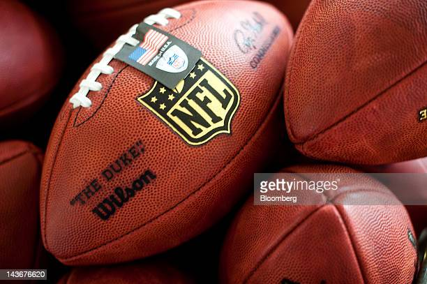 Footballs sit in a bin at the Wilson Sporting Goods Co Wilson Football Factory in Ada Ohio US on Wednesday May 2 2012 Since 1941 every NFL game ball...