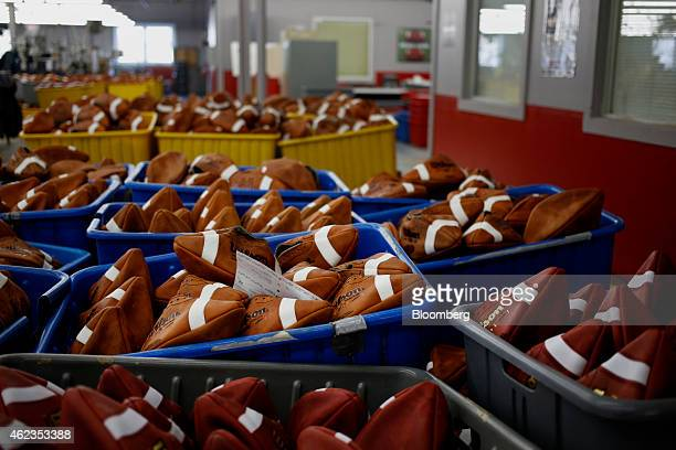 Footballs sit in a bin before being laced up at the Wilson Sporting Goods Co factory in Ada Ohio US on Monday Jan 26 2015 Super Bowl XLIX features...