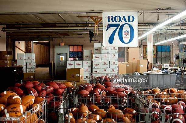 Footballs sit in bins at the Wilson Sporting Goods Co Wilson Football Factory in Ada Ohio US on Wednesday May 2 2012 Since 1941 every NFL game ball...