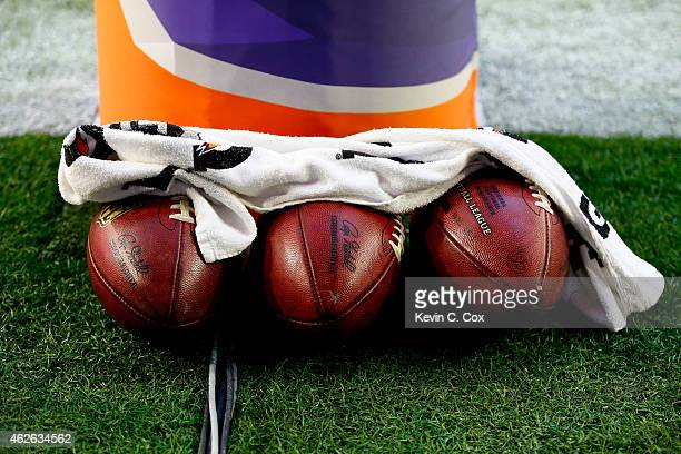 Footballs sit near a goal post prior to Super Bowl XLIX between the New England Patriots and the Seattle Seahawks at University of Phoenix Stadium on...