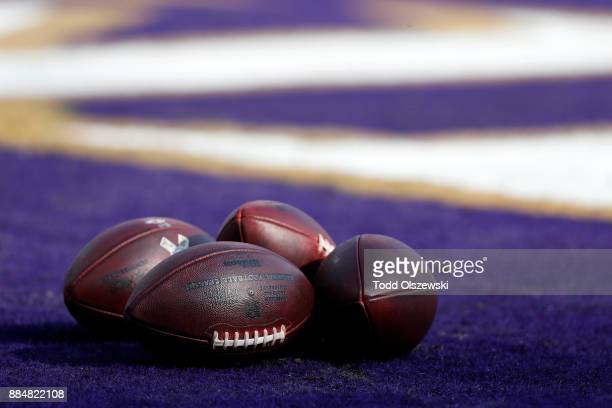 Footballs sit on the field prior to the game between the Baltimore Ravens and the Detroit Lions at MT Bank Stadium on December 3 2017 in Baltimore...