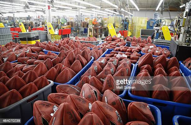 Footballs wait to be stamped with the opponents names for Super Bowl XLVIII at the Wilson Sporting Goods football factory on January 19 2014 in Ada...