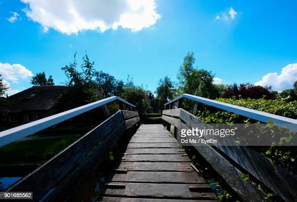 Footbridge Amidst Trees Against Sky