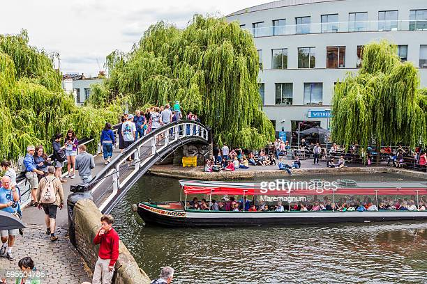 footbridge and boat on the regent's canal - camden london stock pictures, royalty-free photos & images