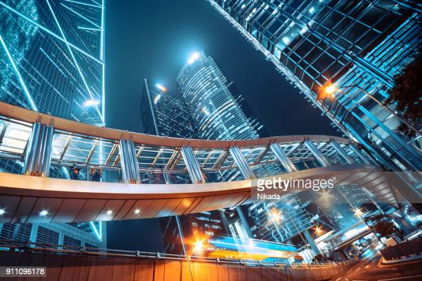 footbridge and corporate buildings in central hong kong - financial district stock pictures, royalty-free photos & images