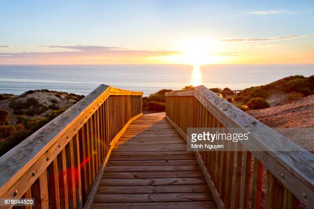 footbridge and sunrise, over sea, adelaide, south australia, australia - adelaide stock pictures, royalty-free photos & images