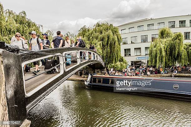 footbridge and typical boat on the regent's canal - camden london stock pictures, royalty-free photos & images