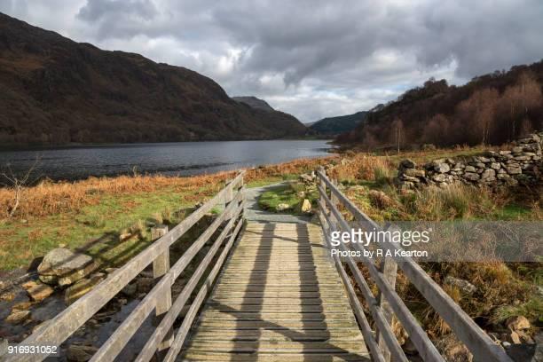 Footbridge beside Llyn Dinas in the Snowdonia national park, North Wales