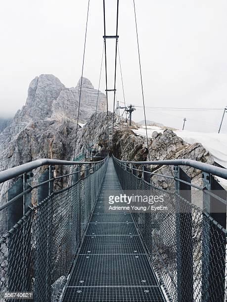 Footbridge In Mountains