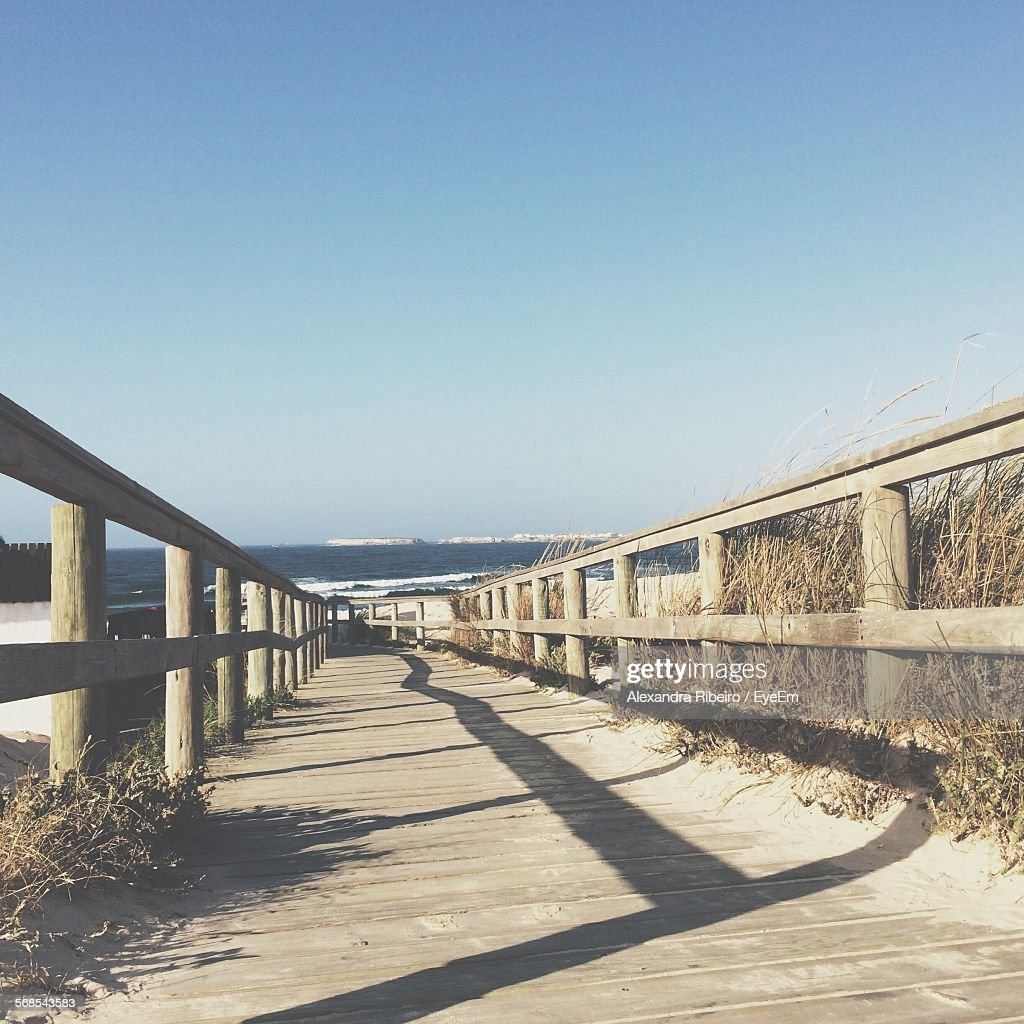 Footbridge Leading Towards Beach Against Clear Blue Sky : Stock Photo