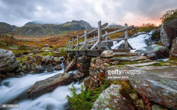 footbridge, ogwen, snowdonia, wales - bangor wales stock photos and pictures