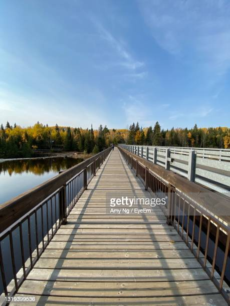 footbridge over lake against sky - ontario canada stock pictures, royalty-free photos & images