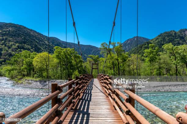 footbridge over river against sky - northern rail stock pictures, royalty-free photos & images