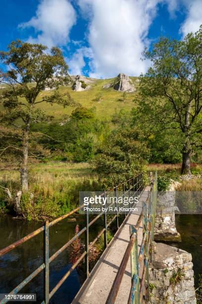 footbridge over the river wye, upperdale, peak district, derbyshire - local landmark stock pictures, royalty-free photos & images