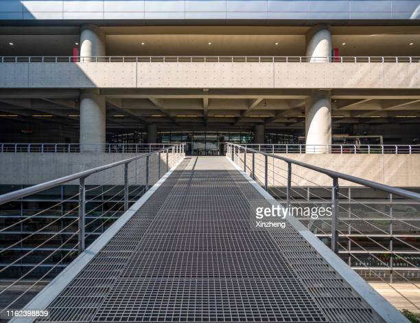 footbridge, parking lot - pedestrian walkway stock pictures, royalty-free photos & images