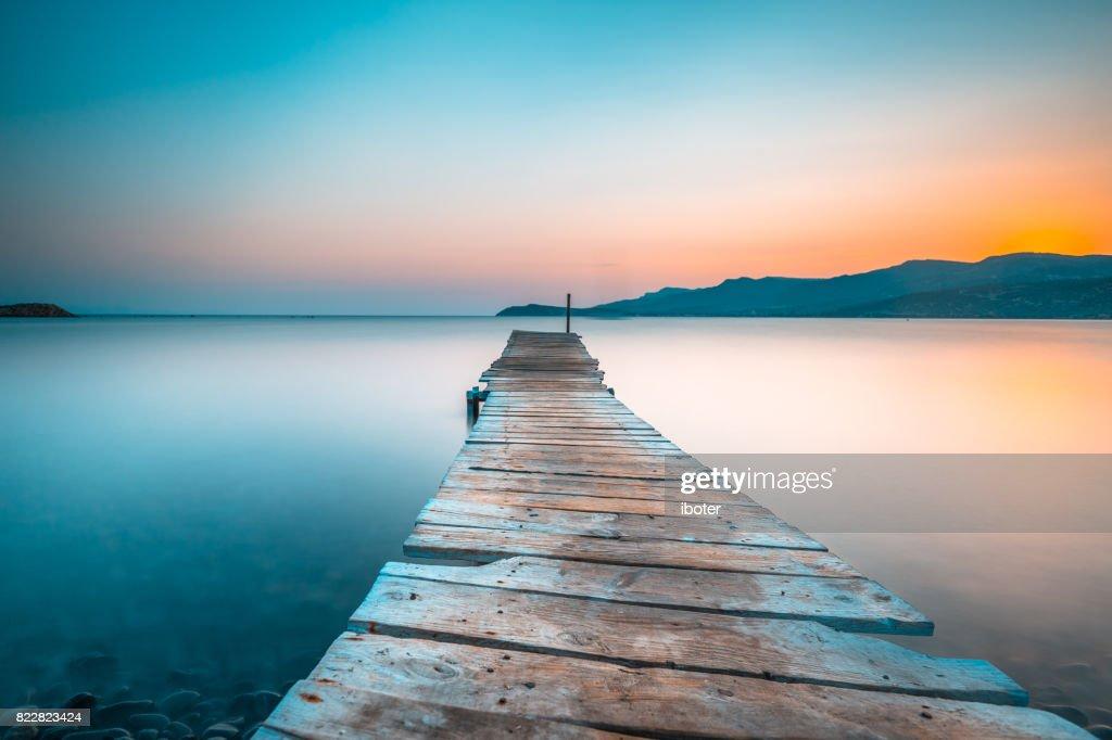 Footbridge sea beach sunset : Stock Photo