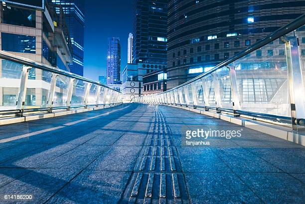 footbridge with cityscape at night