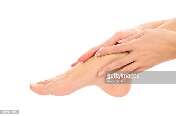 footcare (smearing cream) - white women feet stock pictures, royalty-free photos & images