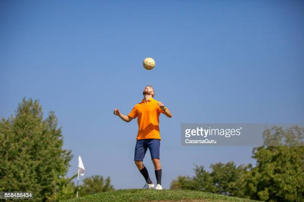 FootGolf Player Heading the Ball