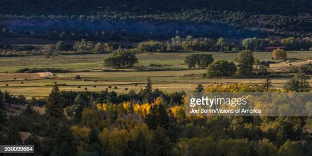 Foothills of San Juan Mountains in Autumn with hay bails in distance on Double RL Ranch owned by Ralph Lauren outside Ridgway Colorado