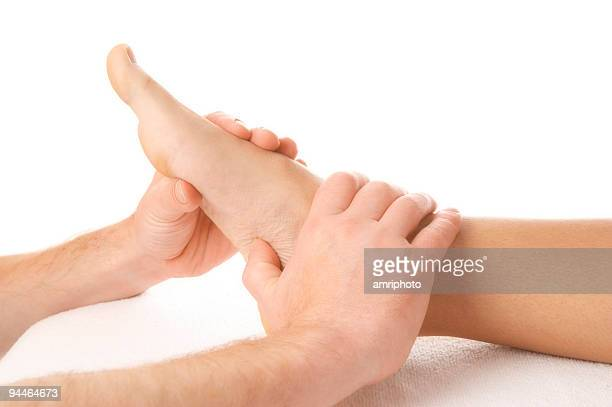footmassage 1 - foot massage stock photos and pictures