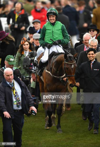 Footpad ridden by Ruby Walsh celebrates victory in the Racing Post Arkle Challenge Trophy Novices' Chase on Champion Day of the Cheltenham Festival...