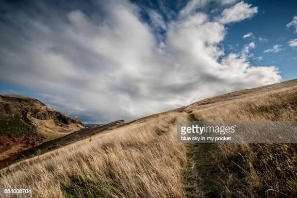 A footpath across the top of the Crags towards. Arthur's Seat, Edinburgh, Scotland. UK.