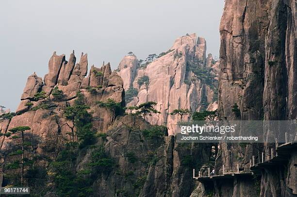 footpath along rock face, xihai (west sea) valley, mount huangshan (yellow mountain), unesco world heritage site, anhui province, china, asia - unesco stock pictures, royalty-free photos & images