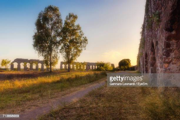 Footpath By Ancient Roman Aqueduct Against Sky