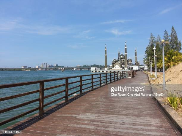 footpath by sea against sky - terengganu stock pictures, royalty-free photos & images