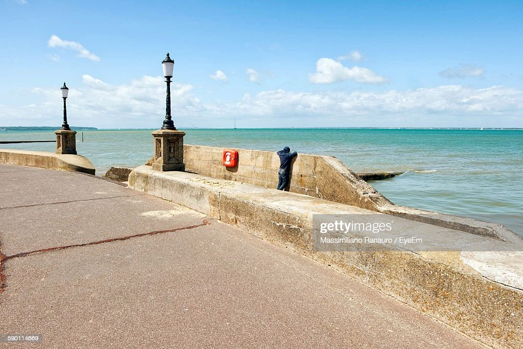 Footpath By Sea Against Sky : Stock Photo