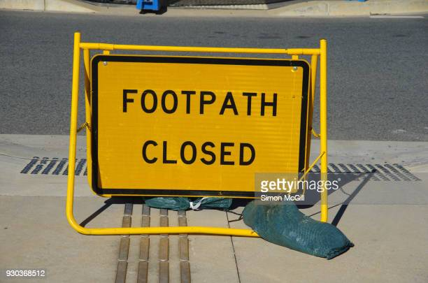 footpath closed temporary folding sign next to a road - detour sign stock photos and pictures