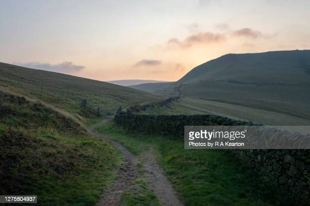 footpath in peak district hills at dawn - country road stock pictures, royalty-free photos & images