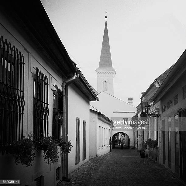 footpath leading towards church against clear sky - kosice stock pictures, royalty-free photos & images